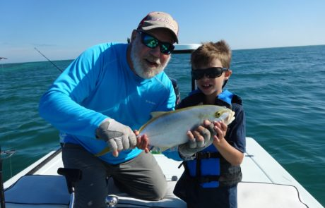 Captain Mark and little boy holding an Amberjack