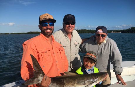 Charter group holding a Cobia.