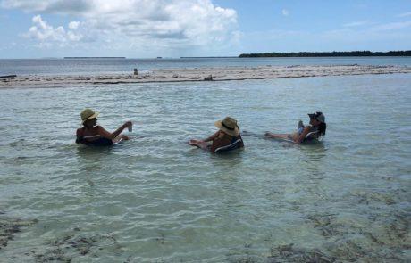 Three women enjoying a Lower Keys sandbar.